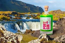 Ports of Portgin - Portgin - Port of Reykjavík 50 cl, grüner Gin in den die Nordlichter einfangen sind. Flasche auf dem Hang eines Wasserfall in Island.